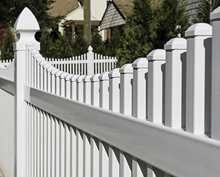 A typical white picket fence.